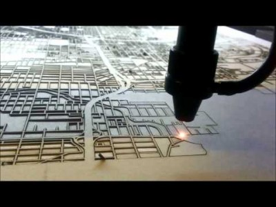 Laser cutting a map of Atlanta.