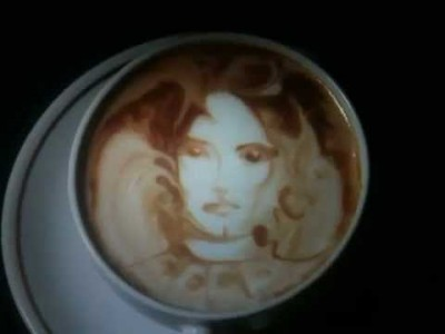 Chris Phillips Etching a Face in his Coffee