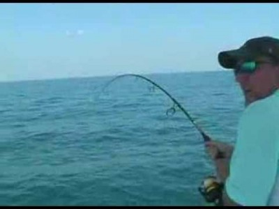 Large Fish jumps into a Fishing Boat!