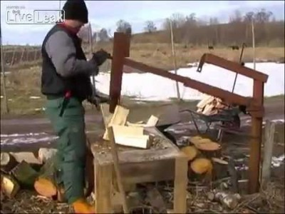 Ukrainian Man with his Wood Cutting Machine