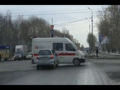 Car Crashes and Flips an Ambulance Over