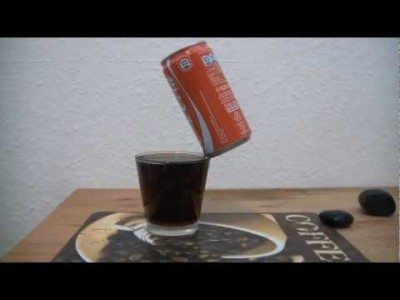 Coke Can balancing on the Edge of a Glass