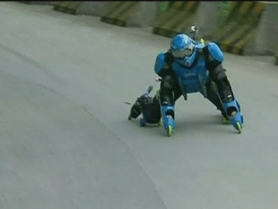 Man races down Chinese Mountain in 32-Wheeled Outfit