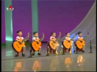 North Korean children playing the Guitar. Creepy as Hell.