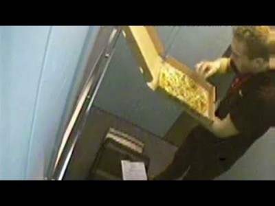 Caught on Camera: Pizza Delivery Guy eats Toppings of Pizza he Delivers