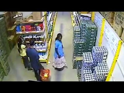 Woman steals Beer under her Skirt