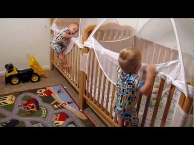 Twins putting themselves to Bed