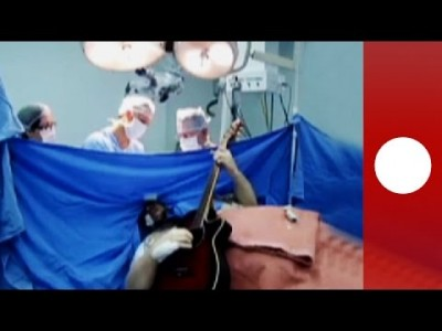 Brain surgery patient plays guitar during operation