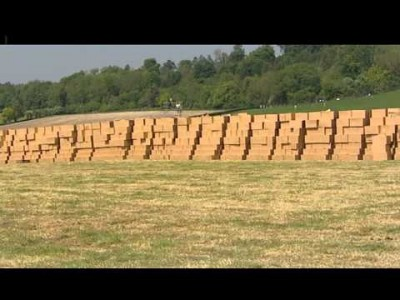 Stuntman skydives onto a Hay Bale Target without a Parachute