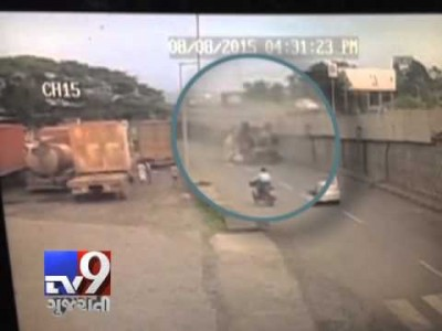 CCTV: Tyre burst causes Truck to fall off Bridge in India