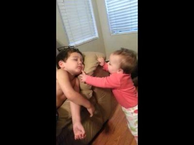 Baby Sister tries to wake up her Big Brother